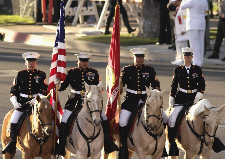 The U.S. Marine Corps Mounted Color Guard ride in the 125th Rose Parade in Pasadena, California January 1, 2014. (Jonathan Alcorn/Reuters photo)