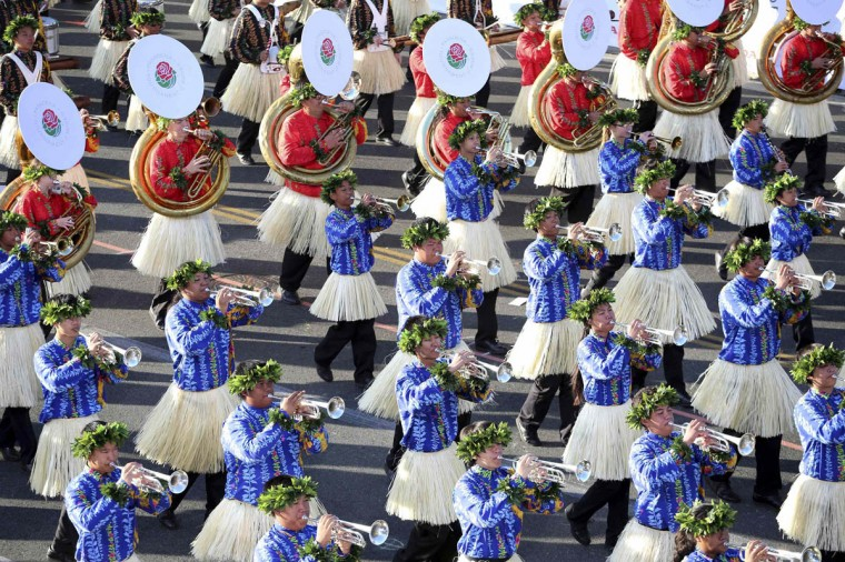 "The Hawai'i All State Marching Band participates in the 125th Rose Parade. The 2014 Rose Parade, themed ""Dreams Come True"", features florally decorated floats, marching bands, and equestrian units on a five and a half mile parade route through Pasadena. (Jonathan Alcorn/Reuters photo)"