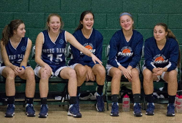 The Notre Dame Prep bench shares a laugh during the Notre Dame Prep versus St. Paul's School for Girls at St. Paul's in Lutherville on January 10, 2014. Notre Dame Prep defeated St. Paul's 51-45.