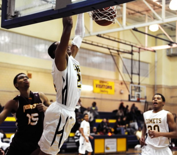Catonsville's Antwan Pearson dunks during a basketball game against at Catonsville High School on Wednesday, Jan. 8, 2014.