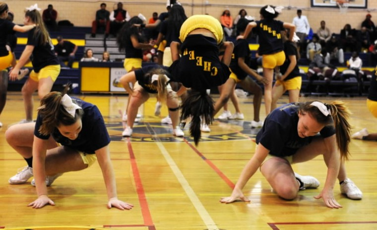The Catonsville High School cheerleaders perform at half time during a basketball game against at Catonsville High School on Wednesday, Jan. 8, 2014.