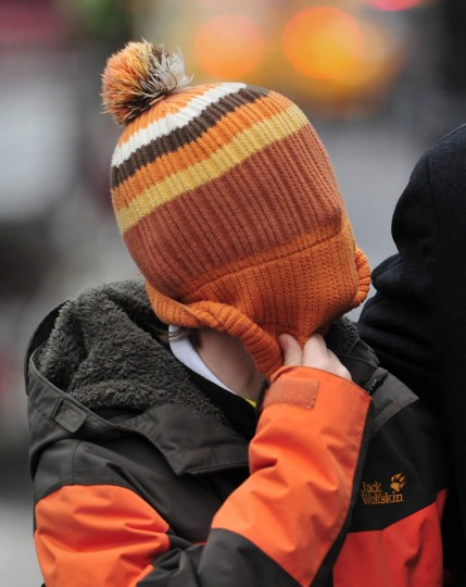 A boy pulls his cap over his face as he walks near Central Park bundled against the cold in advance of a winter storm in New York. The northeastern United States prepared Thursday for snow, high winds and frigid temperatures, as a gust of wintry weather bore down on New England and surrounding states, cancelling flights. Temperatures in New York were expected to drop to 10 degrees Fahrenheit (minus 12 degrees Celsius) with a windchill factor of minus nine degrees Fahrenheit, according to national weather forecasts. (Stan Honda/Getty Images)