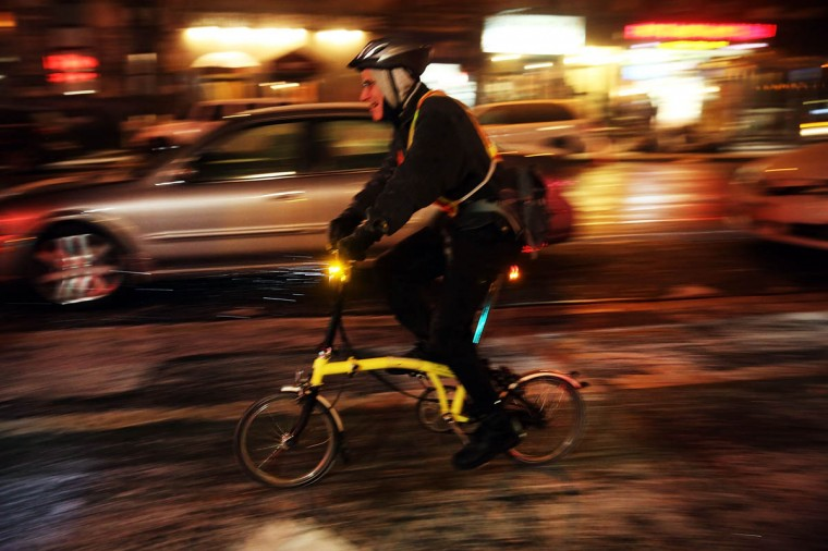 A man rides his bicycle as snow falls in the Brooklyn borough of New York City. (Spencer Platt/Getty Images)