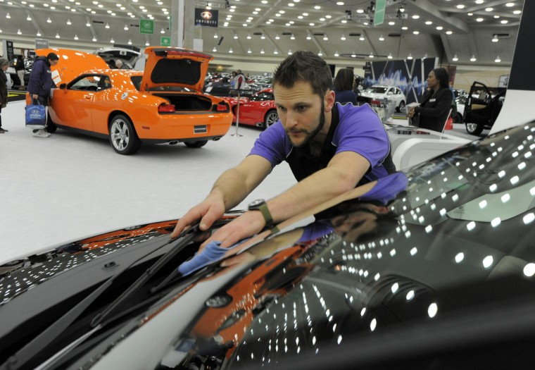 Brian Kuttel details a 2014 Fiat 500L Lounge at the 2014 Motor Trend International Auto Show at the Baltimore Convention Center. (Lloyd Fox/Baltimore Sun)