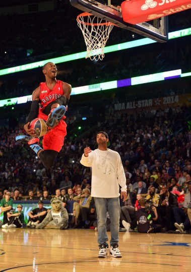 Musical artist Drake holds the ball for Toronto Raptors guard Terrence Ross (31) during the 2014 NBA All Star dunk contest at Smoothie King Center. (Bob Donnan/USA Today Sports)