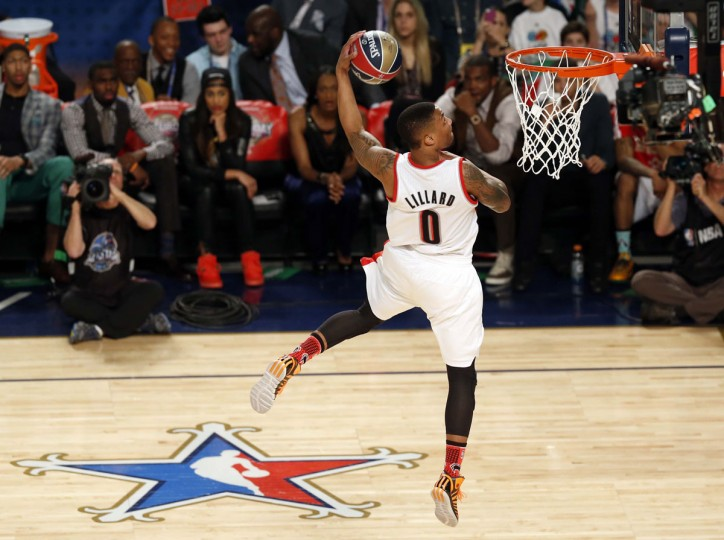 Portland Trailblazers guard Damian Lillard (0) dunks during the 2014 NBA All Star dunk contest at Smoothie King Center. (Derick E. Hingle/USA Today Sports)