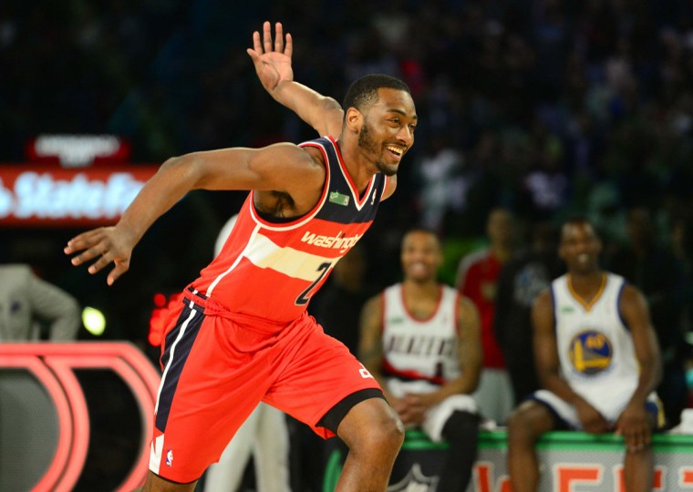 Washington Wizards guard John Wall celebrates after his dunk during the 2014 NBA All Star dunk contest at Smoothie King Center. (Bob Donnan/USA TODAY Sports)