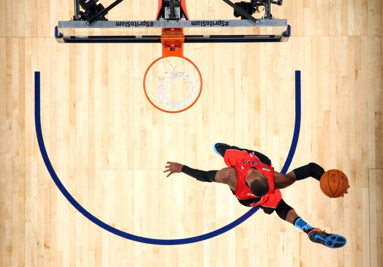 Toronto Raptors guard Terrence Ross (31) dunks during the 2014 NBA All Star dunk contest at the Smoothie King Center. (Ronald Martinez/USA Today Sports)
