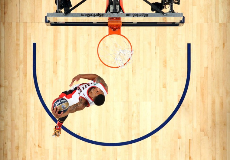 Portland Trailblazers guard Damian Lillard dunks during the 2014 NBA All Star dunk contest at the Smoothie King Center. (Ronald Martinez/USA Today Sports)