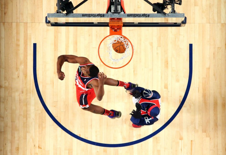 Washington Wizards guard John Wall dunks during the 2014 NBA All Star dunk contest at the Smoothie King Center. (Ronald Martinez/USA Today Sports)