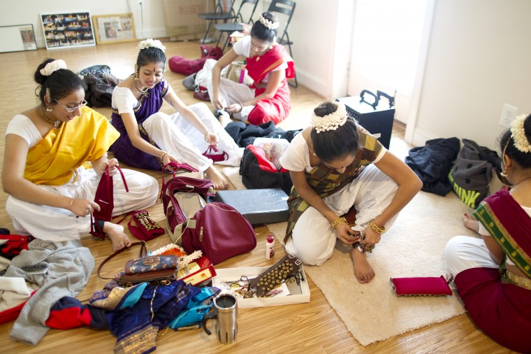 Dancers from a classical Indian dance group Jayamangala rehearse at company director Shobha Subramanian's home in Laurel on Saturday, Feb. 15, 2014. (Jen Rynda/BSMG)