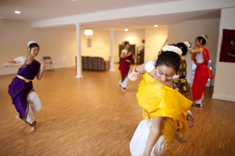 Anusha Nathan, 17, of Ellicott City rehearses with her classical Indian dance group Jayamangala at company director Shobha Subramanian's home in Laurel on Saturday, Feb. 15, 2014. (Jen Rynda/BSMG)