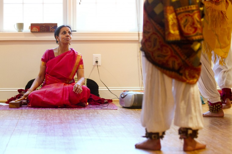 Company director Shobha Subramanian, left, intsructs dancers from the classical Indian dance group Jayamangala during a rehearsal at her home in Laurel on Saturday, Feb. 15, 2014. (Jen Rynda/BSMG)
