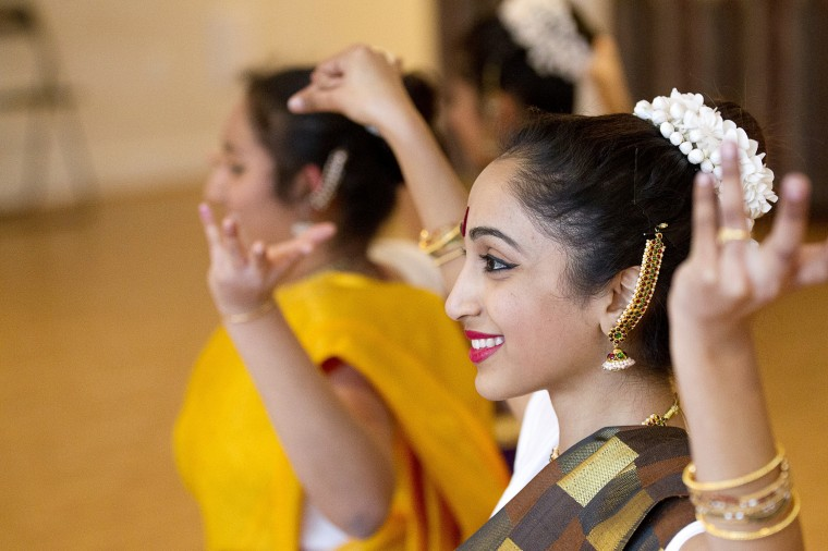 Amritha Jayanti, 17, of Lanham rehearses with the classical Indian dance group Jayamangala at company director Shobha Subramanian's home in Laurel on Saturday, Feb. 15, 2014. (Jen Rynda/BSMG)