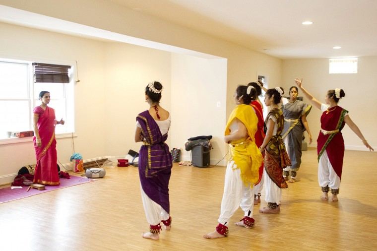 Company Director Shobha Subramanian, left, instructs dancers from a classical Indian dance group Jayamangala during a rehearsal her home in Laurel on Saturday, Feb. 15, 2014.