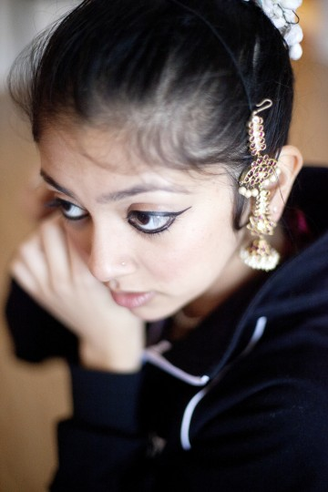 Nisha Pawar, 21, of Greenbelt gets ready to rehearse with the classical Indian dance group Jayamangala at company director Shobha Subramanian's home in Laurel on Saturday, Feb. 15, 2014.