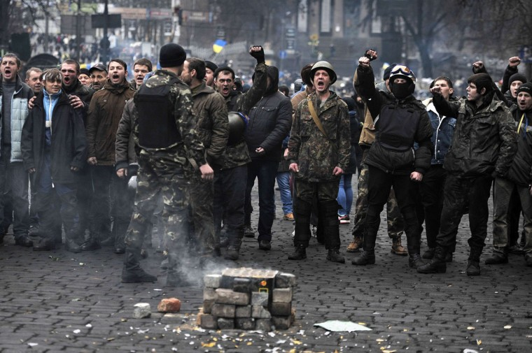 Anti-government protesters celebrate in central in Kiev on February 22, 2014. The regime of Ukraine's president appeared close to collapse on February 22 as the emboldened opposition took control of central Kiev and key government and parliament positions and voted to immediately free its jailed leader Yulia Tymoshenko. (Louisa Gouliamaki/AFP/Getty Images)