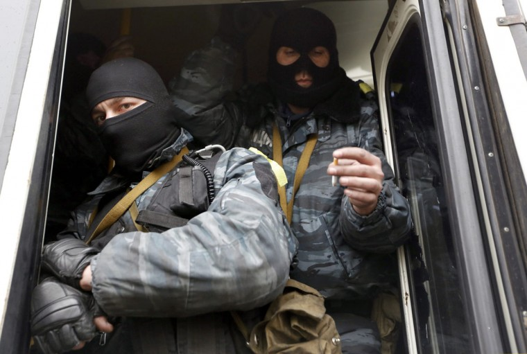 Members of Berkut anti-riot unit embark in a bus as leave their barracks in Kiev February 22, 2014. The heads of four Ukrainian security bodies, including the police's Berkut anti-riot units, appeared in parliament on Saturday and declared they would not take part in any conflict with the people. (Yannis Behrakis/Reuters)