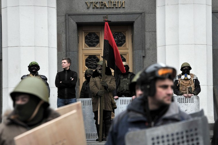 Anti-government activists stand guard at the entrance of the Parliament in Kiev on February 22, 2014. (Louisa Gouliamaki/AFP Getty Images)