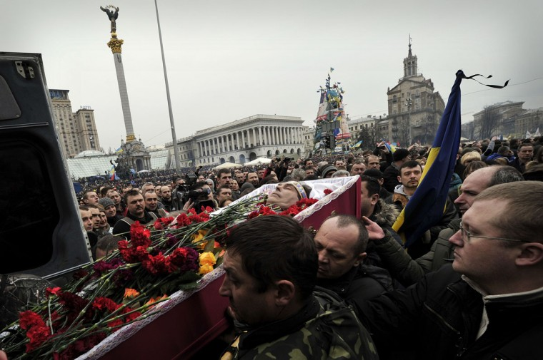 People carry a coffin during a funeral service for two anti-government protesters killed during the recent clashes on the Independence square in Kiev on February 22, 2014. (Louisa Gouliamaki/AFP/Getty Images)