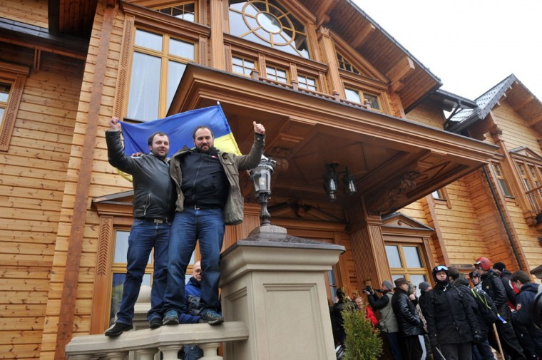 People express their joy in front of the main building of Ukrainian President Viktor Yanukovych's residency near Kiev on February 22, 2014. (Genya Savilov/AFP Getty Images)