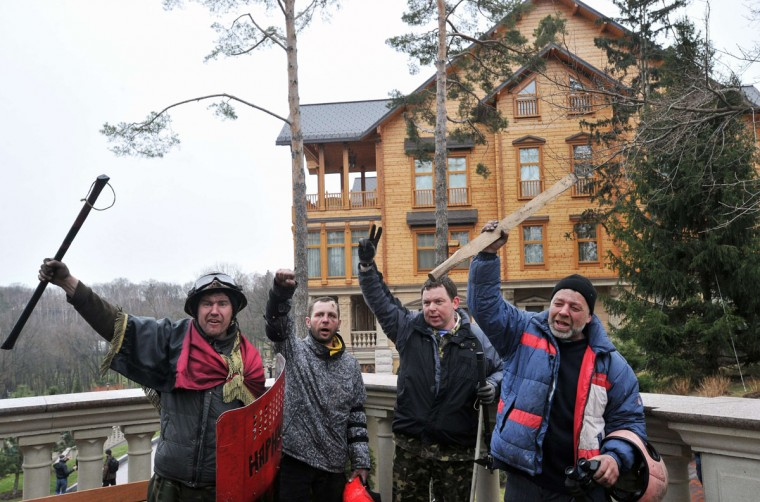 Anti-government protesters pose in front of the main building of Ukrainian President Viktor Yanukovych's residency near Kiev on February 22, 2014. (Genya Savilov/AFP Getty Images)