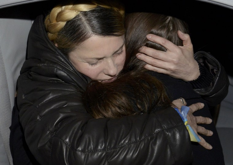 Ukrainian opposition leader Yulia Tymoshenko (left) hugs her daughter Yevgenia upon arrival at the airport in Kiev February 22, 2014. Tymoshenko was freed on Saturday from the hospital where she had been held under prison guard for most of the time since she was convicted in 2011. (Maks Levin/Reuters)
