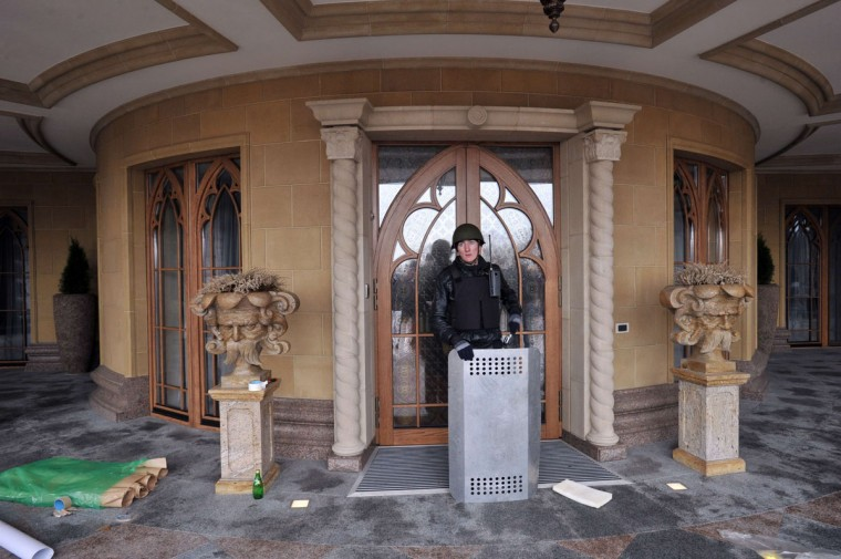 An anti-government activist stands guard at the main building of Ukrainian President's residency near Kiev on February 22, 2014. (Genya Savilov/AFP Getty Images)