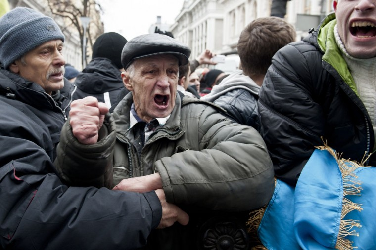 Anti-government protesters react outside the Ukrainian Parliament as they wait for President Viktor Ianoukovytch's resignation, in Kiev, on February 22, 2014. (Piero Quarant/AFP Getty Images)