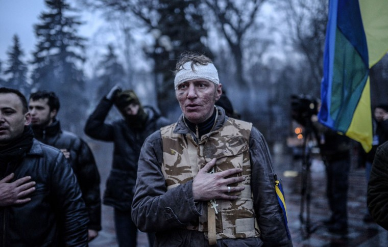 Anti-government activists react after the vote of the Ukrainian Parliament as they rally outside the parliament building in Kiev on February 22, 2014. (Bulent Kilic/AFP Getty Images)