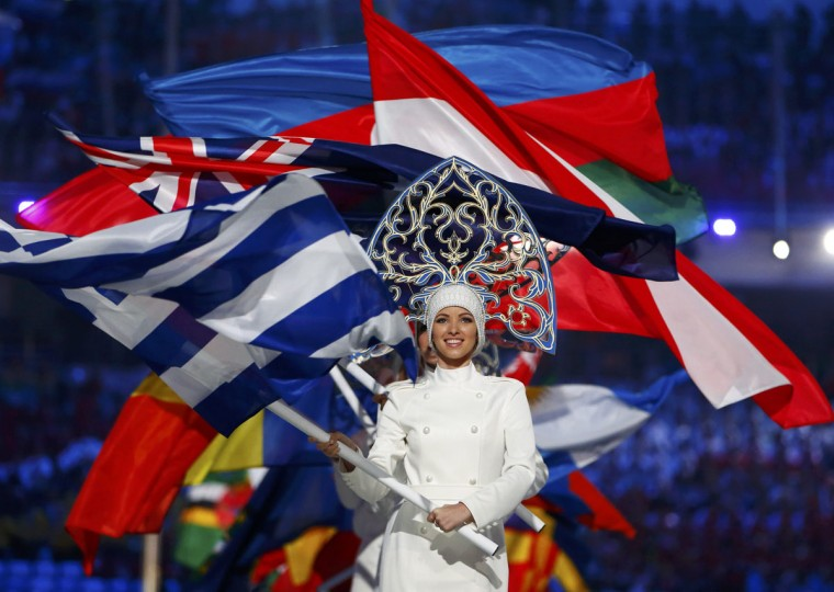 Flagbearers arrive holding their national flags in the closing ceremony for the Sochi 2014 Winter Olympic Games February 23, 2014. (Marko Djurica/Reuters)