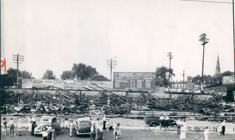 Baltimore residents (and presumably some Orioles fans) look out the wreckage left in the wake of the fire that burned down Oriole Park in Baltimore, July 1944. (Baltimore Sun Archives)