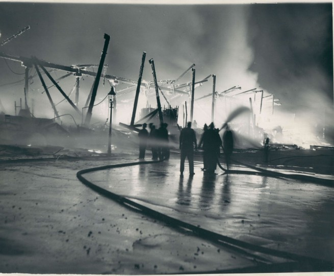 Firemen try to stop the fire that destroyed Oriole Park in Baltimore on July 4, 1944. (Baltimore Sun Archives)