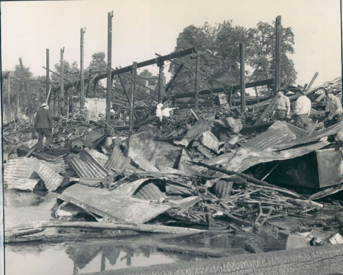 Crews survey what was left of Oriole Park after it was destroyed by a fire on July 4, 1944. (Baltimore Sun Archives)