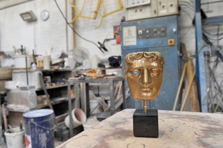 The BAFTA mask awards are crafted ahead of the British Academy Film Awards -- which take place on Sunday February 16 --  at New Pro Foundries on February 3, 2014 in West Drayton, England.  (Photo by Gareth Cattermole/Getty Images)