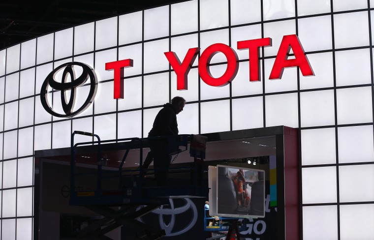 A worker prepares a Toyota display for an auto show in the Midwest earlier this year.  The Philadelphia International Auto Show continues this week at the Pennsylvania Convention Center. (Photo by Scott Olson/Getty Images)