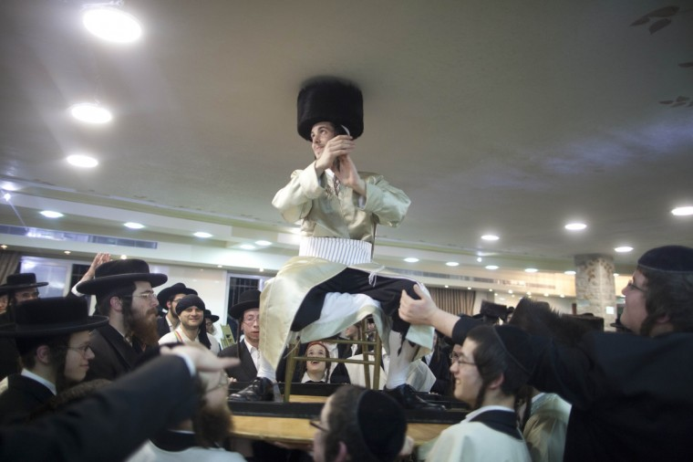 Ultra-Orthodox Jewish groom Aharon Cruise (C) dances during his wedding in the Mea Shearim neighborhood in Jerusalem, Israel. Mea Shearim is one of the oldest Jewish neighborhoods in Jerusalem. It is populated mainly by Haredi Jews. (Lior Mizrahi/Getty Images)
