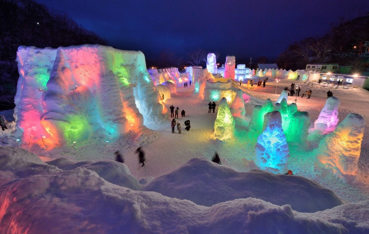 People visit the Chitose-Lake Shikotsu Ice Festival illuminated by colorful light to produce a fantastic world in Chitose on January 24, 2014. The annual ice festival will be held until February 16. ||  KAZUHIRO NOGI - AFP/Getty Images
