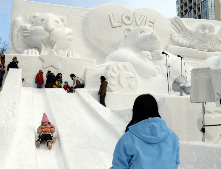 Children play on a snow slide during the 65th annual Sapporo Snow Festival. The week-long festival started with a total of 198 snow statues on display. (Toshifumi Kitamura/Getty Images)