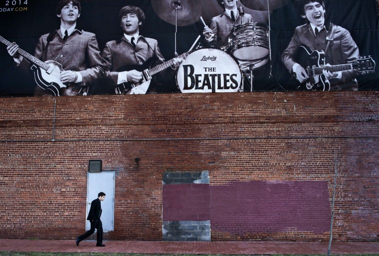 A man walks past the Washington Coliseum on January 15, 2014 in Washington, DC. The Beatles performed their first live concert in North America at the Washington Coliseum on February 11, 1964. AFP PHOTO/Brendan SMIALOWSKIBRENDAN SMIALOWSKI/AFP/Getty Images    Related post on RetroBaltimore.com: The Beatles in Baltimore