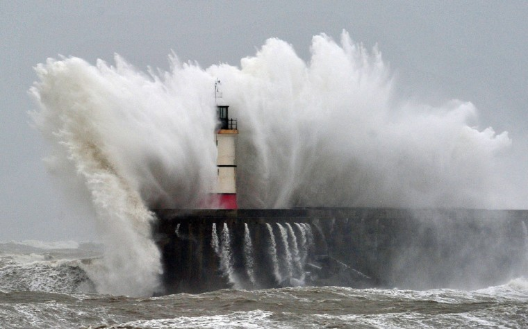 Newhaven Lighthouse is battered by waves during stormy weather in Newhaven on the southern coast of England. More than 8,000 homes were without power in southwest England after fresh storms battered the region, sending huge waves crashing onto the coastline and damaging sea defences. (Glyn Kirk/Getty Images)