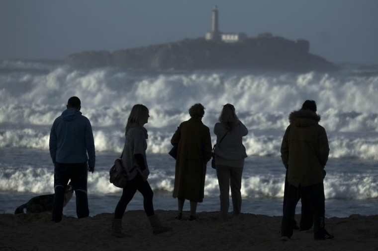 People look at the waves on Somo beach during heavy seas, in Ribamontan del Mar, near Santander. Fierce waves were pounding seafronts and fishing boats off northern Spain, where authorities issued alerts for storm tides and strong winds for Wednesday, with snow forecast in some places. (Pedro Armestre/Getty Images)