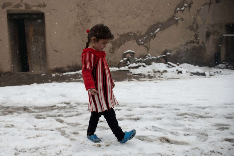 An Afghan child walks through the snow during snowfall in Kabul. The Afghan capital has experienced its third snowfall of the winter. (Nicolas Asfouri/Getty Images)