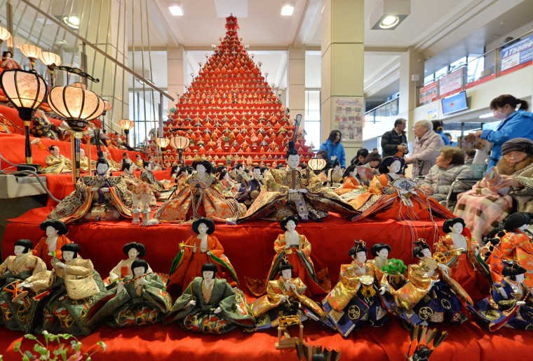 Girls' Day: More than 2,400 Japanese ornamental dolls (hina dolls) are displayed for the Konosu Bikkuri Hinamatsuri or doll festival at Konosu City Hall, Saitama prefecture on February 19, 2014. Hinamatsuri, also known as Girls' Day, is celebrated in Japan usually on March 3. The festival will be held here until March 8. (KAZUHIRO NOGIKAZUHIRO NOGI/ - AFP/GETTY IMAGES)