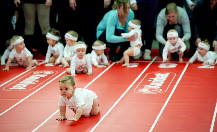 Toddlers take part in a race during the annual Nine Months Fair (Negenmaandenbeurs) in Amsterdam. This event offers new parents and parents-to-be all kind of information about pregnancy and baby and is held from February 19 to 23. (Robin Van Lonkhuijsen/Getty Images)