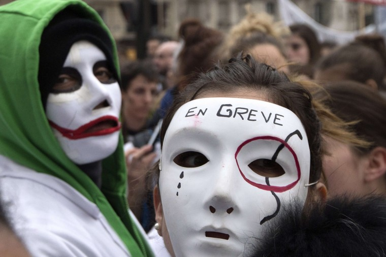 Midwives, wearing white masks and bearing the words ''on strike'''' take part in a demonstration to ask the government to clarify their status in Paris. Some of the midwives on strike, are asking to leave the public service to become hospital practitioners. (Joel Saget/Getty Images)