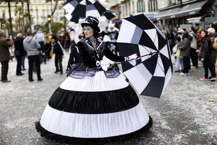"""Nice Carnival: Dancers parade on February 25, 2014 during the Nice Carnival, southeastern France. The theme of this year's carnival, running from February 14 until March 4, 2014, is the """"King of Gastronomy"""". (VALERY HACHE/ - AFP/GETTY IMAGES)"""