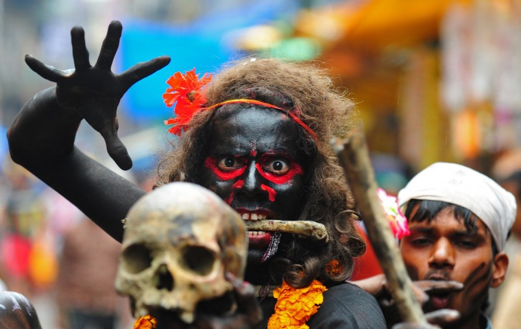 An Indian Hindu devotee holds a human skull during a procession for Maha Shivaratri, dedicated to the Hindu god Lord Shiva, in Allahabad. Hindus mark the Maha Shivratri festival by offering special prayers and fasting to Lord Shiva, the god of destruction. (Sanjay Kanojia/Getty Images)