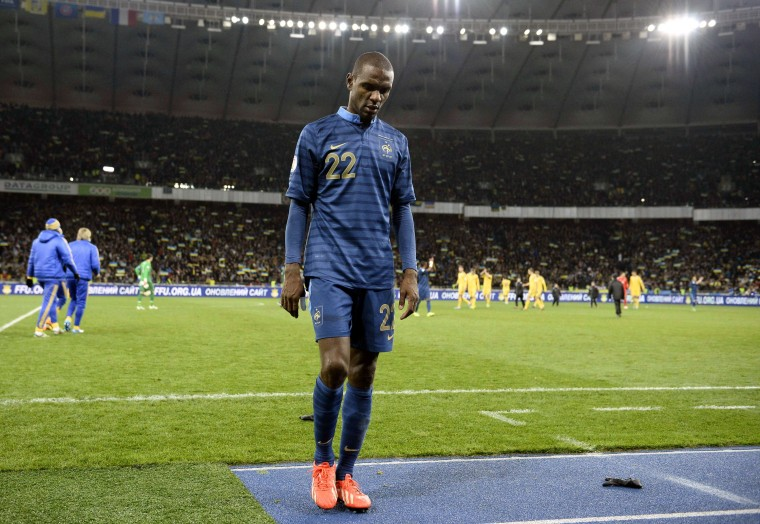French-Dutch friendly: This file picture taken on November 15, 2013 shows France's Eric Abidal leaving the pitch at the end of the 2014 FIFA World Cup qualifying playoff first leg match against Ukraine at the Olympic Stadium in Kiev. Abidal wasn't called by French coach Didier Deschamps to play France's next friendly match against the Netherlands on March 5. (FRANCK FIFE/ - AFP/GETTY IMAGES)