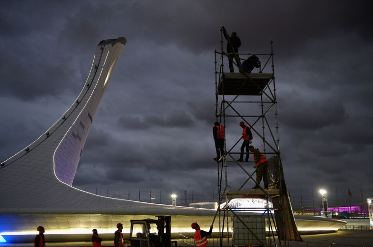 Workers are seen inside the Olympic Park prior to the Sochi 2014 Winter Olympics. (Photo by Pascal Le Segretain/Getty Images)